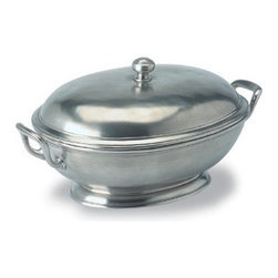 Match Pewter - Large Oval Soup Tureen by Match Pewter - The large oval soup tureen is hand forged in Italy and bears a symbol from the region in which it was made. Match pewter is a testament to the values of craft and authorship often overlooked in this age of speed and convenience. Hand-wash this piece in warm water using liquid dish soap. Dry the pewter completely.
