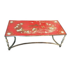 """Pre-owned Vintage Trouvailles Chinoiserie Cocktail Table - A fabulous vintage Hollywood Regency style Chinoiserie cocktail or coffee table. The top is elaborately hand painted in beautiful gold and silvery enamel on a rich orange-red lacquer background. The table is raised on steel legs joined by a stretcher. The original label under the top reads, """"Trouvailles Inc. ~ Waterton, Mass.""""    In the late 1960s - 1970s Trouvailles Furniture produced some of the finest and most desirable furniture in the world. They were a custom furniture importer and antiques dealer that catered to the trade. Their clients were wealthy collectors and interior designers. No longer in production, Trouvailles' creations are now becoming prized collector's pieces."""