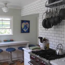 Small Cottage Kitchen Remodel - Rejuvenation Lighting, Wolf Range, subway tile with dark grout