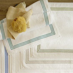 "Grand Triple Embroidered Bath Rug, 21 x 34"", Espresso - Like bath linens in a luxury hotel, our plush white collection is loomed of the highest-quality cotton, then accented with beautiful embroidery. 20 x 34"" Looped and flat pile creates a tone-on-tone effect. Sage is finished on two sides with a triple row of satin-stitched embroidery as pictured. Espresso, Dark Porcelain Blue, Thyme, Red Oak and Honeycomb are finished with a frame border of triple row satin-stitched embroidery around all four sides. Machine wash. Monogramming is available at an additional charge. Monogram is 4"" and will be placed in the center of the bath rug. Catalog / Internet only. Made in Portugal."