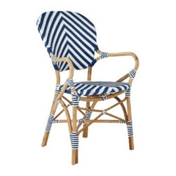 Serena & Lily - Chevron Riviera Armchair Navy - What could be better than our timeless Riviera Chair? The same sleek frame (inspired by the bistros of 1930s Europe) in a bold new chevron pattern. We love the classic colour mix, too a rich shade against a crisp white. Handcrafted of sustainable rattan with a woven plastic seat and back, it's great inside or in the garden. Look closely and you'll notice the wonderfully organic marks created while bending and stretching the rattan into shape a time-honored technique perfected by the French. Try it with the other silhouettes in this collection. A slight variation in how the colors are woven keeps things interesting.   View dimensions