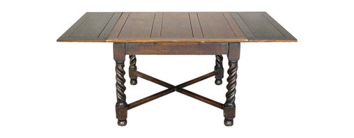 Antiques - Antique English 6Ft Solid Oak Barley Twist Drawleaf Dining Pub Table - This is a beautiful antique English 6ft solid oak barley twist square/rectangular drawleaf dining *pub table. Its top surface has a very nice finish and very good wood grain quality and though it shows some minor age appropriate wear it is in very good condition as it is. Its leaves are darker but they do match the rest of the table which gives it a very unique and attractive look. Since its a drawleaf table the sides conveniently slide in and they extend the table from 41.75in to 71.5 inches. It has a traditional skirt and it features gorgeous barley twist legs with blocks, an X stretcher and bun feet. It may have some age appropriate wear including scratches and scuffs but overall it is in very good cosmetic and structural condition and it is strong and sturdy. This is an outstanding piece of furniture that will enrich your home decor!*English Pub Tables are Great! Pub tables are popular for a variety of reasons. They are small and fit in small spaces yet the draw leaves extend so that most are five feet or more in length. They are solid wood and generally made of oak and have attractive wood bases in a variety of designs from Queen Anne legs to heavy twin pedestals. Some have a traditional stretcher base while others have diagonal stretchers. When it comes to functionality, there are few pieces that can be put to so many uses. They perform well as a kitchen table and equally well as a small dining room table. Some come with matching buffets, which make them a real prize. They make great game tables that can also double as an overflow table for big family gatherings. Students love pub tables as desks and study tables. They are a nice size to use as a computer table. There are few pieces of furniture that demonstrate the beauty, functionality, versatility and the long life of an English Pub Table.