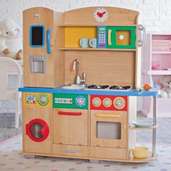 "KidKraft Cook Together Play Kitchen - Let your future chefs practice in the KidKraft Cook Together Play Kitchen and soon they'll be ready to prepare you four-course meals for real! This kid-resistant play kitchen is made from sturdy laminated MDF and plastic so it can stand up to rigorous cooking sessions. Bright primary colors will activate your kids' imaginations so they can concoct dishes worthy of a five-star restaurant. Every major appliance has been included in this play kitchen. Doors open and knobs turn for a more realistic experience. Your little culinary artists can pull ingredients out of the fridge and jot down a grocery list on the chalkboard when they use the last egg. They can slow cook a roast in the oven whip up a roux on the """"gas"""" stove or just give up and heat a frozen dinner in the microwave. See they've been watching you cook! To make sure your children learn that cleaning up is just as important as cooking this kitchen includes a dishwasher and a washing machine for hand towels and aprons. They can hand wash utensils in the sink too; the basin is removable for quick and easy cleaning if needed. The speckled countertop provides plenty of prep space and ample shelving organizes food utensils and cookware (not included). The clock with moving hands keeps your line cook on schedule and the cordless phone lets kids take call-in orders or gossip with friends while stirring the stew. About KidKraftKidKraft is a leading creator manufacturer and distributor of children's furniture toy gift and room accessory items. KidKraft's headquarters in Dallas Texas serves as the nerve center for the company's design operations and distribution networks. With the company mission emphasizing quality design dependability and competitive pricing KidKraft has consistently experienced double-digit growth. It's a name parents can trust for high-quality safe innovative children's toys and furniture."