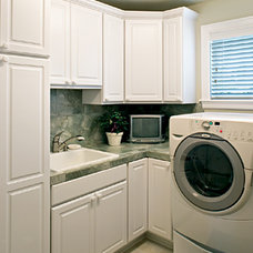 Mediterranean Laundry Room by Canyon Creek Cabinet Company