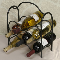J & J Wire - J & J Wire 6-Bottle Wine Holder Multicolor - 3078 - Shop for Wine Bottle Holders and Racks from Hayneedle.com! Ensure you have a wine for every meal and every palate with the mobile J & J Wire 6-Bottle Wine Holder. This classic wine holder has a sturdy handle so you can safely transport six bottles of wine from one setting to another. This freestanding unit is proudly made in the USA from wrought iron with a black powder-coat finish.About J & J Wire Inc.Located at the Industrial Park in Beatrice Nebraska J & J Wire Inc. started 25 years ago as a wire-forming business manufacturing mostly houseware items. Since then the company has grown into a metal fabrication business serving customers in many different manufacturing sectors in the United States and Canada. From quilt racks to wine racks J & J Wire is committed to creating handmade works of art at affordable prices.