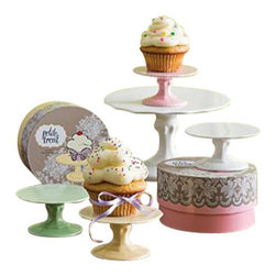 """Rosanna - Set Of Eight Colored Cupcake Stands - Add some fun flavor, and color by displaying your petite treats on our porcelain mini cupcake stands!                * Set includes: 2 pink, 2 yellow, 2 white and 2 green.         * Dimensions: 4""""w x 2""""h.         * Care: Hand wash recommended.         * Gift Boxed"""