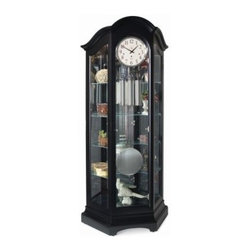 Decorah Grandfather Clock by Howard Miller - The Decorah Grandfather Clock by Howard Miller is the ultimate in luxury and functionality. Behind the full-length side glass and gracefully arched bonnet top four generous adjustable shelves and one fixed shelf offer the convenience to display all of your treasures and collectibles. This piece features an ebony luster finish over select hardwoods and veneers a large 300mm round dial frame with Arabic numerals brushed nickel weight shells and pendulum and Ridgeway's exclusive Dual Touch Lamp lighting. The mechanical cable-driven movement plays the Westminster chimes and has an automatic night silence option. You'll be impressed by the craftsmanship of this curio clock. The well-crafted case undergoes a multi-step finishing process which includes staining sealing sanding applying multiple coats of lacquer and highlighting. Every Ridgeway grandfather clock is machine-sanded and then the critical parts are hand-sanded which are just more reasons why you would enjoy this remarkable piece. A free engraved brass plate is available after delivery. See details below. 2 Year Warranty. Free Engraved Brass Plate AvailableOnce you receive your new Ridgeway grandfather clock you'll have the option of ordering a free engraved brass plate. Simply fill out the ordering form that comes with your clock and indicate the name or message you want to appear on the plate (maximum of 27 characters). Allow four weeks for plate delivery.