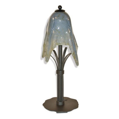 Mathews & Company - Wrought Iron Buttercup Table Lamp with Small Glass Shade - This elegant table lamp resembles the delicate nature of a growing buttercup while lending the strength of durable wrought iron. The gorgeous cloudy gray shade is made from recucled hand blown glass with gentle scallops along the rim. An artistically crafted wrought iron base resembles the leaves of a buttercup with its leaf-like bundled strands. For those who enjoy modern elegance, the Buttercup collection is a perfect fit. The color palate may be cool, but the warmth that these lovely floral lamps lend to a room cannot be duplicated. Pictured in Cloudy Gray shade and Black finish.