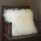 Mongolian Lamb Pillow - This fluffy, Mongolian lamb pillow is so much fun! I would get the 17-by-17 size, put it on the family room sofa and expect it be hoarded!