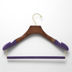 "Frontgate - Set of Three Women's Suit Hangers with Felted Bars - Available in 100% birch wood with high-gloss Bubinga Finish, purple flocking, and brass hardware or 100% maple wood construction with satin finish, black flocking, and chrome hardware. Available in two different widths (petite and standard) for optimal sizing. Each hanger flares to a generous 1-3/4"" depth at the shoulders to help prevent stretching and distortion. Fully contoured. Sold as a set of three. These Luxury Women's Suit Hangers offer heavier garments or those with important shoulder construction, like suits and jackets, the essential support they require to hang properly in the closet without stretching or losing their shape. Felted and notched shoulders on all hangers securely, gently grip garments to prevent stretching and keep wide-neck garments from sliding off the hangers.  .  .  . . . Felted trouser bars eliminate the creasing caused by ordinary locking-bar mechanisms ."