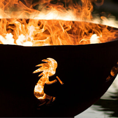 """Fire Pits - Great for Fall and Winter - Combining the inquisitive gecko, the bright noon day sun and the Hopi Indian God, Kokopelli this fire pit pays homage to our southwest heritage. Release the free spirit in you today! This original design is made to order by Tennessee craftsman in the heartland of America. They are constructed from heavy duty 1/4"""" thick mild carbon steel and are the most durable steel fire pit made anywhere.  he inner bowl has a high temperature resistant coating and comes with a 1 1/2"""" diameter rain drain. The outer iron oxide patina is maintenance free and the fire pit can be left outside in all weather conditions. Over time and use the patina will mature and darken a few shades and then remain permanent forever. Each unique fire pit is individually numbered by the artist on an attached brass plaque."""