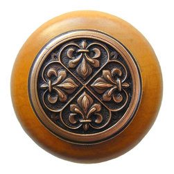 "Inviting Home - Fleur-de-Lis Maple Wood Knob (antique copper) - Fleur-de-Lis Maple Wood Knob with hand-cast antique copper insert; 1-1/2"" diameter Product Specification: Made in the USA. Fine-art foundry hand-pours and hand finished hardware knobs and pulls using Old World methods. Lifetime guaranteed against flaws in craftsmanship. Exceptional clarity of details and depth of relief. All knobs and pulls are hand cast from solid fine pewter or solid bronze. The term antique refers to special methods of treating metal so there is contrast between relief and recessed areas. Knobs and Pulls are lacquered to protect the finish. Alternate finishes are available. Detailed Description: The Fleur-de-lis means ""flower of the lily"" It was used to represent French royalty. It was said that the king of France Clovis who started using the symbol of the Fleur-de-lis because the water lilies helped guide him to safety and aided him in winning a battle. The design in the Fleur-de-Lis pulls is arranged in alternating positions of the Fleur-de-lis. These pulls are a great match for the Fleur-de-lis knobs which have the Fleur-de-lis pattern arranged in a circle. The different shapes of decorative hardware make the cabinet doors and drawers interesting to look at."