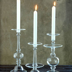 "Helena Glass Taper Holder - 5"" x 10"" - When you need a candlestick that has a classic look with a romantic flair, the Helena Glass Taper Holder is an ideal choice. Add a grouping to your floral centerpiece for a sure touch of refined glamour. Group different sizes for stunning tabletop decor at your next dinner party and illuminate your night with the soft candlelight the Helena Glass Taper Holder will provide."