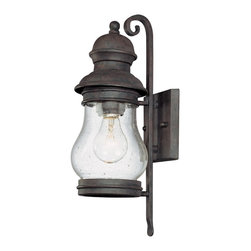 "Troy - Hyannis Port Collection 15 1/4"" High Outdoor Wall Light - The Hyannis Port outdoor wall light from Troy Lighting is inspired by the charm and history of Hyannis and beautiful Cape Cod. This lantern-style design is crafted from hand-forged iron which is presented in a special Hyannis Port bronze finish. A rounded body of clear seeded glass gives way to warm illumination. A classic design to light your outdoor spaces. Hand-forged iron construction. Hyannis Port bronze finish. Clear seeded glass. Takes one 60 watt bulb (not included). 15 1/4"" high. 5 1/4"" wide. Extends 7"" from the wall. 7 3/4"" from mounting point to top.  Hand-forged iron construction.   Hyannis Port bronze finish.   Clear seeded glass.   Takes one 60 watt bulb (not included).   15 1/4"" high.   5 1/4"" wide.   Extends 7"" from the wall.   7 3/4"" from mounting point to top."