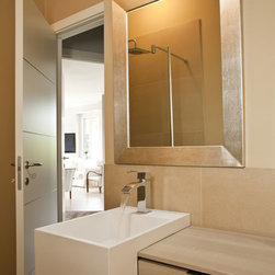 Custom golden silver framed bathroom mirror - The frame's moulding is a wide flat profile with a finish of silver/stainless steel.