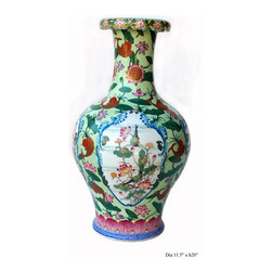 Chinese Flower Koi Fishes Pastel Green Vase - This beautifully made vase has pastel green with white wave pattern as the base color. There are Koi fishes painted along with flowers on the surface. Each frame is drawn with birds. It is a decent piece for display as well as collection.