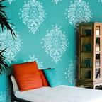 Grande Bombay Paisley Wall Motif Stencil - Stay totally on trend with our Grande Bombay Paisley Wall Stencil from Royal Design Studio. Stencil this large paisley as a focal point over a bed, mantel, or piece of furniture. Or create a random wallpaper pattern as shown. Bold, bright colors make a seriously fun statement.