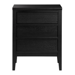 """Spotlight Ebony Filing Cabinet - The spotlight is on clean lines and generous capacity for both files and supplies. Top drawer offers generous storage for office supplies and accessories. And what appears to be the bottom """"two drawers"""" is actually one deep file that accommodates either letter- or legal-size files. Finished in a deep ebony stain with concealed cutaway handles to streamline the look."""
