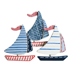 "Little Elephant Company - Michael Sail Boat Quilt Clips - Set/3 - Beautiful quilt clips that transform your treasured baby quilts and comforters into charming hanging artwork for your child's room.    Very easy to use.  ***    This listing is for a set of three (3) hand painted sailboat quilt clips. Colors used are chambray blue, navy, blue ribbon, red, country twill, and white in stripes, stitches and plaid patterns.    These quilt clips are perfect for nautical and transportation themed bedding sets.    Each sailboat measures 3.88 in. x 3.8 in.    How many quilt clips do I need?  - For a quilt that is still stiff and new, you will only need 2 quilt clips for up to 36 inches wide. Many people will do 3 quilt clips just for the look, though. For a quilt that has been washed and is pliable, 2 clips will be sufficient for up to 36 inches, but you may want 3 clips to help keep the center from sagging. For a quilt 36 to 42 inches wide, use 3 to 4 clips. For a quilt 42 to 50 inches, use 4 to 5 clips.    How do the quilt clips work?  - The only hardware is needed is a long nail, approximately 1 1/2"" to 2 1/2"" in length.  - Measure how far apart you would like the clips to be.  - Decide how high on the wall they will be placed and mark your first spot. Using a level, measure out and mark the second spot.  - Place your nails into the wall at a 45 degree angle. IMPORTANT: If your nail is not at a 45 degree angle, the clip may slip off the nail.  - Clip the quilt and slide the back of the clip over the nail.    What are the clips made of?  - Designs are made of layered wood. A few of our designs also have layered felt.   - Clips on the back are a sturdy plastic so as not to damage your fabric."