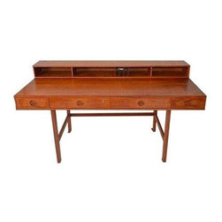 Used Mid Century Peter Lovig Nielsen Flip Top Desk - One of the most beautiful and classic of mid-century Danish desks, Peter Lovig's 'flip-top' desk is a fantastic design and beautifully made in teak. It features four pull out drawers with unique tab drawer pulls. The upper storage portion features two drawers and open storage for papers.  It is attached with solid brass hinges. This portion folds over and down to create a larger work surface, and also can then be used as a partners desk. Flip top offers cubbies with two letter trays and vertical storage compartments. Back of desk has additional storage compartments.