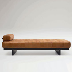 De Sede - De Sede DS-80 Daybed - This daybed is a logical and faithful re-design of the celebrated de Sede classic and has lost none of its fascination. Its extravagant leather-patchwork covering together with back cushioning that can be positioned as required caused a sensation more than 30 years ago. The model has been only slightly altered to fit the spirit of the new collection. Anthracite stained satin lacquered solid beech frame. This luxurious leather daybed gets its support from SEDEX upholstery with SEDE-Lux covering. Manufactured by de Sede in Switzerland. Price includes delivery to the USA.