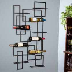 "Oenophilia Mid-Century 10-Bottle Wall Wine Rack - The mid-20th Century is known for minimalist art innovative use of metals and glamorous cocktails. Add a little Dean Martin to your life with the Oenophilia Mid-century 10-Bottle Wall Wine Rack and enjoy the same casual glamour. Ten bottles wind their way through this playful 3-D grid. No wonder this is a best-seller: with wine labels growing more colorful and artistic the mid-century design is perfect for today! About OenophiliaWith a name Greek in origin meaning """"the love of wine """" Oenophilia delights in fulfilling its mission to bring together products that allow others to love wine with the passion that Oenophilia does. After creating their first product in 1983 the Oenophilia team has continued to produce and manufacture superior wine accessories and is known as one of the leading wholesale suppliers of wine accessories and gifts in the U.S. Although located in Hillsborough NC traveling the world has allowed Oenophilia to provide customers with a premium extensive collection of wine accessories including openers wine racks glassware and gifts. Oenophilia carries their signature line of original designs and packaging as well as exceptional brands such as Vacu-Vin Metrokane Rogar Srewpull and Spiegelau. Bringing eclectic wine products competitive pricing and responsive customer service to the table is the Oenophilia team's way of sharing their passion while achieving their goal of providing customers with a luxurious one-stop shopping experience."
