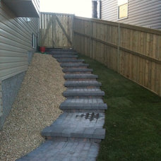 Traditional Landscape by Oasis Landscaping