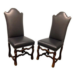 Pre-owned Black Matte Leatherette Chairs - Set of 4 - Design Plus Gallery brings us a set of four black chairs. These wooden base structures are upholstered a black matte leatherette and outlined a silver nailhead trim. These chairs are the perfect addition to your dining space. The frame is a traditional style while the back upholstery and silver nail head trim create a boldness with a little elegance.     Seat Height: 20""