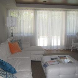 Yiliam | Miami Beach Villa | Grommet - Sheer - Ripple Fold - Black Velvet - Ripple fold sheer drapes - ceiling brackets - center open - ceiling to floor.