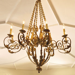 "Frontgate - Twisted French Chandelier - Massive size and dramatic design. Provides ample illumination while making a brilliant focal point for any room. Chain measures 72"". Takes eight 60-watt candelabra bulbs (not included). UL listed for indoor use. An elegant execution of a traditional French design, the wrought-iron Twisted French Chandelier flaunts a deep-ocean finish that adds an authentic, aged appearance. Elegant scrolls and acanthus leaves accent the eight arms in this grandly scaled, hand-forged masterpiece.  .  .  .  .  . Feather dust only . Professional installation recommended . Allow 2 weeks for delivery ."
