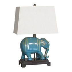 Uttermost Pradesh Blue Ceramic Table Lamp - Distressed blue ceramic accented with aged ivory undertones and solid mango wood details. Distressed blue ceramic accented with aged ivory undertones and solid mango wood details. The rectangle tapered hardback shade is a beige linen fabric.