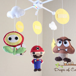 Super Mario Bros. Mobile by Drops of Color - If your Mario-themed room is for future Mario Bros. fans, this mobile is a sweet addition. It is completely hand-stitched, no sewing machine used. Wow!