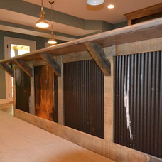 Rustic Basement by Hearth & Stone Builders