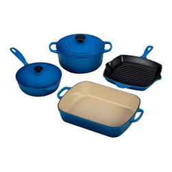 Le Creuset - Le Creuset Marseille 6 Piece Signature Set - MS1406-59 - Shop for Cookware Sets from Hayneedle.com! The placid blue of the Le Creuset Marseille 6 Piece Signature Set makes us feel like we're looking out over the Mediterranean. Made by Le Creuset with signature color and obsessive attention to detail this set is sure to be enjoyed by future generations. Each cast iron piece distributes and retains heat for wonderful cooking properties. Food stays warm longer in cast iron. If seasoning scares you; relax. This set is ready to use out of the box with easy-care enameled surfaces that release foods and resist dulling staining sticking and burning. The serene exterior surfaces are resistant to cracking and chipping. The roaster saucier and French oven have light sand-colored interiors which complete the Mediterranean motif and allow you to see when food is done. The Skillet Grill features high-temperature-worthy Satin Black enamel that is suitable for browning searing and caramelizing. All handles are designed with oven mitts in mind. Lids are designed to fit tightly to keep heat and flavor in. Quart for quart you won't find lighter pieces in genuine cast iron. All pieces clean up easily in the dishwasher or in warm soapy water.Additional Features:Saucier knob is heat safe to 375 FFrench oven knob is heat safe to 500 FSet weighs 38.8 lbs.4 1/2 Qt. French Oven measures 6.75H x 10 diam. in.5 1/4 Qt. Roaster measures 15.75L x 10.25W x 3H in.Square Skillet Grill offers a 10W x 10L x 1.75H in. cooking surface5 1/4 Qt. Roaster measures 16.5L x 95W x 5H in.Made in FranceAbout Le Creuset of America Inc.From its cast iron cookware to its teakettles and mugs Le Creuset is a global standard of inimitable color and quality. Founded in 1925 in the northern French town of Fresnoy-Le-Grand Le Creuset still produces enameled cast iron in its original foundry. Its signature color Flame was modeled after the intense orange hue of molten cast iron within a cauldron (or creuset in French) and has been a Le Creuset bestseller from the company's first year to the present day.Though best known for its vibrantly colored cookware and original inventions such as the Dutch oven Le Creuset has also forged a name as a creator of stoneware mugs and enamel-coated stainless steel teakettles. The style and performance of Le Creuset's Cafe Collection and tea accessories are rooted in classic French cookware: bold colors cylindrical loop handles unmatched thermal resistance and heat distribution and of course the iconic Le Creuset three-ring accent. Through its consistent qualities of authenticity originality and innovation Le Creuset maintains a connection to both heritage and modernity.