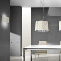 """Axo - Axo Obi Pendant Lamp - OBI43, OBI63, OBI100 - The Obi pendant lamp (US OBI 43, US OBI 63, US OBI 100) from Axo was designed by Manuel Vivian and made in Italy. The small Obi pendant lamp is for indoor installation and is available as a table, floor, ceiling and wall fixture. This collection has chromeplated fittings, the lampshades and the canopies consist of silken ribbons available in ivory or black and of a semi-reflecting chrome-plated finished sheet inside.   Products description: The Obi pendant lamp (US OBI 43, US OBI 63, US OBI 100) from Axo was designed by Manuel Vivian and made in Italy. The small Obi pendant lamp is for indoor installation and is available as a table, floor, ceiling and wall fixture. This collection has chromeplated fittings, the lampshades and the canopies consist of silken ribbons and of a semi-reflecting chrome-plated finished sheet inside.  The colors Ivory and Black have been discontinued.    Details:                         Manufacturer:                         Axo                                         Designer:                         Manuel Vivian                                         Made  in:            Italy                            Dimensions:                         Small (US OBI 43) - Height: 59"""" (150cm) X Width: 16.8"""" (43cm)             Medium (US OBI 63) - Height: 59"""" (150cm) X Width: 24.8"""" (63cm)             Large (US OBI 100) - Height: 70.8"""" (180cm) X Width: 39.4"""" (100cm)                                                     Light bulb:                                      Small (US OBI 43) - 3 X 60W E26 Incandecent or             3 X 20W E26 Flourescent             Medium (US OBI 63) - 3 X 100W E26 Incandecent or             3 X 20W E26 Flourescent             Large (US OBI 100) - 6 X 100W E26 Incandecent or             6 X 23W E26 Flourescent                                         Material                         Metal, fabric"""
