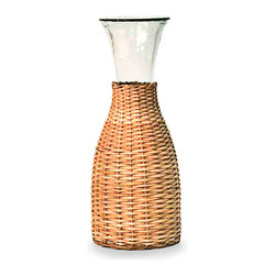 Compagnard Carafe - 25 oz. - The wide-mouthed Campagnarde Carafe adds an urbane upright element to the tabletop or buffet, but it makes this detail tactile and fresh with a layer of basketry extending halfway up the neck, revealing a flare of clear glass above for a marriage of contrast and simplicity. Include amid transitional barware for a personal, relaxed, yet detail-oriented feel.