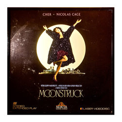 """Glittered Moonstruck Laser Disc Cover - Glittered record album. Album is framed in a black 12x12"""" square frame with front and back cover and clips holding the record in place on the back. Album covers are original vintage covers."""