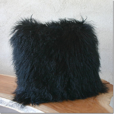 Mongolian Lamb Pillow - Sumptuous pillow in black Mongolian Lamb with a fabric back. The pillows close with a zipper hidden along the seam of one edge, leaving only a sleek pull visible. The cases are filled with feather and down inserts, which create a naturally firm, yet soft cushion. As importantly, the inserts are filled to a medium weight, allowing the pillow to plump nicely, while never appearing overstuffed.