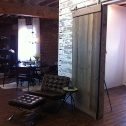 Downtown Loft - Sliding barn door in Dry Brush + feature wall in White White by Timeline Wood