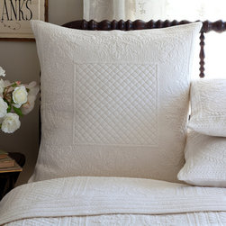 Taylor Linens - Abigail Cream Euro Sham - This sham will rise to the top of your list and your bed. Intricately quilted diamonds, rectangles, leaves, wreaths, dots and other shapes provide textural interest on the cotton percale. It's also completely machine washable so you can rest easy for sure.