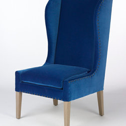 Pair Of Amelie Wing Chairs - Chairs are a less expensive way to add color to a room. The high back and bold color of this one makes quite a statement.
