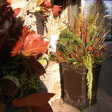 Traditional Outdoor Planters by Calgary Greenworks