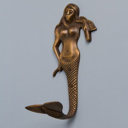 Mermaid Brass Hook - This whimsical Mermaid Brass Hook, featuring a large fin-shaped hook, will make quite a conversation piece in your foyer or entryway.