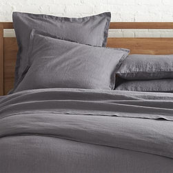 Lino Dark Grey Linen King Duvet Cover - Super soft, washed bedding in solid, gorgeous hues spreads the bed in the comforting touch and relaxed, worn-in style of pure linen. One-inch, self-flange detailing and button closure adds casual tailoring. Duvet insert also available.