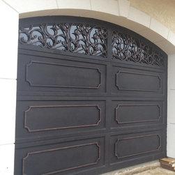 Wrought Iron Doors - New construction home on the beach in VA Beach, VA.  Beautiful custom wrought iron garage doors made to match the front entry door and iron railing.