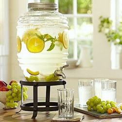"""Farmhouse Glass Beverage Drink Dispenser - Any beverage gains sophistication in this casual update of a French antique. 12"""" diameter, 14.5"""" high; 11-quart capacity (2.75 gallons) Dispenser is made of molded glass. Lid is galvanized iron with a silicone gasket. Stainless steel spigot."""