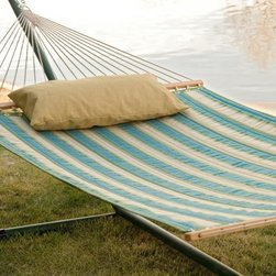 Twin Oaks Quilted Sunbrella Fabric Hammock with Stand - You'll love the choice of colors available to you in the Twin Oaks Quilted Sunbrella Fabric Hammock with Stand package. Two layers of weather-resistant, high-quality Sunbrella fabric are used in the construction of this hammock. The soft Sunbrella fabric, durable even through extensive sun exposure, is quilted over 10 ounces of poly-fill fiber for added comfort. Cushioned and reversible, the hammock features matching colored rope harnesses and solid white oak spreader bars finished with natural linseed oil. You'll be sure to make time to relax when you've got this soft, comfortable hammock beckoning to you from the backyard. Available in several versatile finishes, this heavy-duty 14-gauge steel stand is capable of supporting any spreader bar hammock measuring 12 to 15 feet long and up to 450 pounds. The powder-coated finish is visually attractive and extremely weather-resistant. It assembles quickly without tools. About Twin Oaks Hammocks At Twin Oaks, we believe quality starts at the beginning - in every fiber of every rope and in every grain of every log. We start with yarn specially chosen for weather-resistance and colorfastness, and twist it into durable rope in all colors of the rainbow. Our spreader bars begin as locally harvested white oak logs, which we mill and kiln-dry on site for well-seasoned outdoor use. The completed spreaders are hand-brushed with natural linseed oil and air-dried to maintain the beauty of the wood grain. Our macrame harnesses are made by hand, and carefully measured and trimmed so that every hammock we make is stable and comfortable. For our fabric hammocks, we choose the best outdoor fabric in the industry, and reinforce our stitching to ensure a tough yet beautiful product that will endure the seasons. Finally, at least 40 expertly tied bowline knots complete a hammock that is sturdy and attractive. About Sunbrella Fabric Sunbrella fabric is water-repellent. If kept dry, it will not support the growth of mildew as natural fiber will. Depending on depth of color, Sunbrella fabrics provide up to 98% UV protection. Whites and lighter-colored fabrics provide less protection than darker fabrics. This protective factor is inherent to the product and will not diminish through use or exposure to the sun.