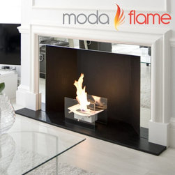Moda Flame - Moda Flame Cavo Table Top Bio-Ethanol Fireplace - GF301900BK - Shop for Fire Places Wood Stoves and Hardware from Hayneedle.com! As the Chinese proverb says: of a small spark a great Moda Flame Cavo Table Top Bio-Ethanol Fireplace ... or something like that. This Asian-inspired table top fireplace will indeed ignite a spark of modernism into your home's decor. Its floating alter-like burner and glass-shield sides create a sleek clean and innovative look that marries the traditional and the contemporary. With all the warmth and beauty of a cozy roaring fireplace the Sky Table Top Fireplace can be moved around the home bringing with it that characteristic ambiance. Whether setting an elegant dining table or just snuggling around a coffee table this burner's versatility is ideal anywhere in the home or on the patio. Designed specifically to work with Moda Flame bio-ethanol this small fireplace can run for four to six hours to accentuate any mood.Moda Flame bio-ethanol is a clean-burning environmentally friendly fuel producing a smokeless and odorless flame that doesn't require any chimney or ventilation. And yet you'll still be able to count on a lovely yellow flame with orange and blue accents that generates plenty of warmth. This ethanol is specifically engineered to keep the earth not just your home nice and clean. Awarded the world's Greenest Choice Ethanol Moda Flame Fuel is a clean sustainable fuel whose only by-products from burning are heat water vapor and a small amount of carbon dioxide comparable to human breath.About Moda FlameModern comfort modern style modern flame. Moda Flame is an innovative concept in home heating and indoor fireplaces. Their bio ethanol-burning fireplaces are eco-friendly and beautiful. This line of modern fireplace designs requires no venting gas lines plug-ins or outlets. Yet provide more heat production less waste and no environmental impact.