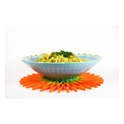 Blossom Trivet - A small, anti-scratch, silicone, flower-shaped gadget.