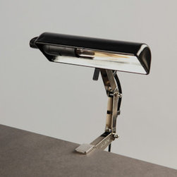Music Stand Light - Although designed to illuminate sheet music, this clip light is a great way to easily add an industrial light fixture to any small space. What a perfect task lamp for your drafting table or work space.